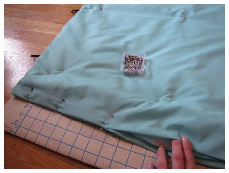 Pin short end closed and pin rest of sleeping bag for quilting