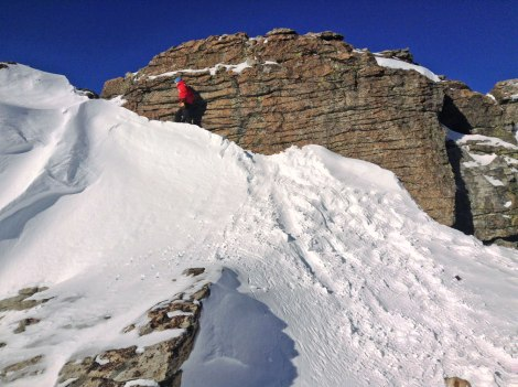 Scrambling to the very top from within the rock amphitheater.